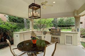 The Summer Kitchen includes a Thermador grill and very spacious L-shaped limestone counters with sink.