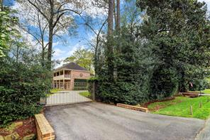 The gated circle driveway allows plenty of guest parking on the property.  There is a two-car garage plus additional covered parking space.