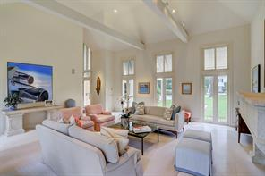 Alternate view of the Living Room showing the raised ceilings with beams which makes the room feel even larger.  The Bermuda shutters offer protection from the sun without compromising the landscaping views.