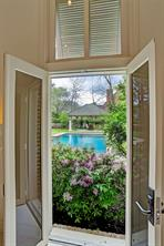 Amazing view from the Living Room towards the pool and freestanding pavilion.
