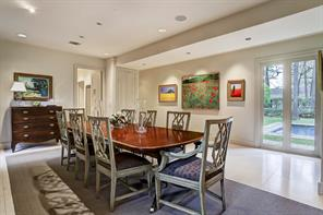 A second view of the Dining Room, with recessed lighting, speakers, and one of the two closets ideal to store dinner and silverware.  The window on the hall leading to the Family Room offers views of the front of the house.