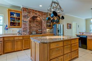 Beautifully appointed kitchen. Gas stovetop, large island, two garbage roll out drawers, lots of cabinet storage and counter space.