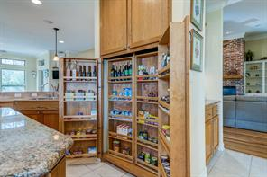 Custom wood pantry. There is more behind these doors. Perfect for organization.