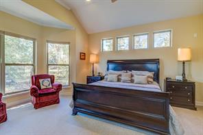 Master bedroom is oversized with a seating area. Room overlooks the backyard.