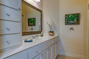 Guest bathroom in main house has a garden bathtub ad lots of cabinet space.