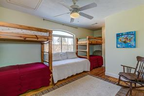 One of two bedrooms in the garage apartment. This room has custom built-in bunk beds and the closets were converted into little play areas for their grandchildren.