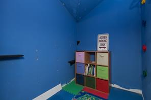 This play area is located in the garage apartmentment adjoining the room with the bunk beds.