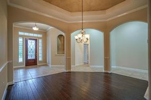 Lovely crown moldings, chair railings, designer light fixture and dramatic ceiling grace your formal dining room.