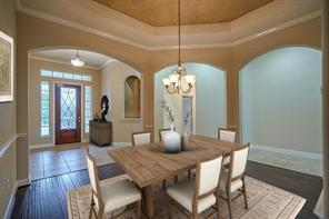 Your guests will enjoy this lovely view of the formal dining room when they enter your front door.
