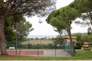 Private tennis courts on the grounds of the villa