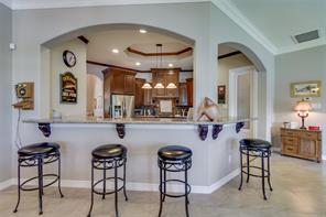 Beautiful custom cabinetry, granite countertops, two sinks, two ovens, and a gorgeous backsplash!  Chef's dream kitchen!