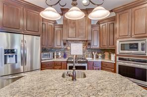 Kitchen provides plenty of counterspace and is open to the rest of the house for views, entertaining, and family time.