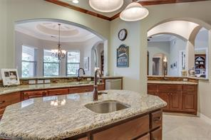 Wet bar provides custom cabinets, granite countertops, and a beautiful backsplash.