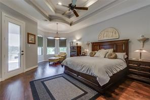 Beautiful vaulted ceiling - door leads to master bathroom.