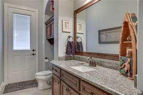 Spacious utility room with plenty of room for additional cabinets or hanging space.
