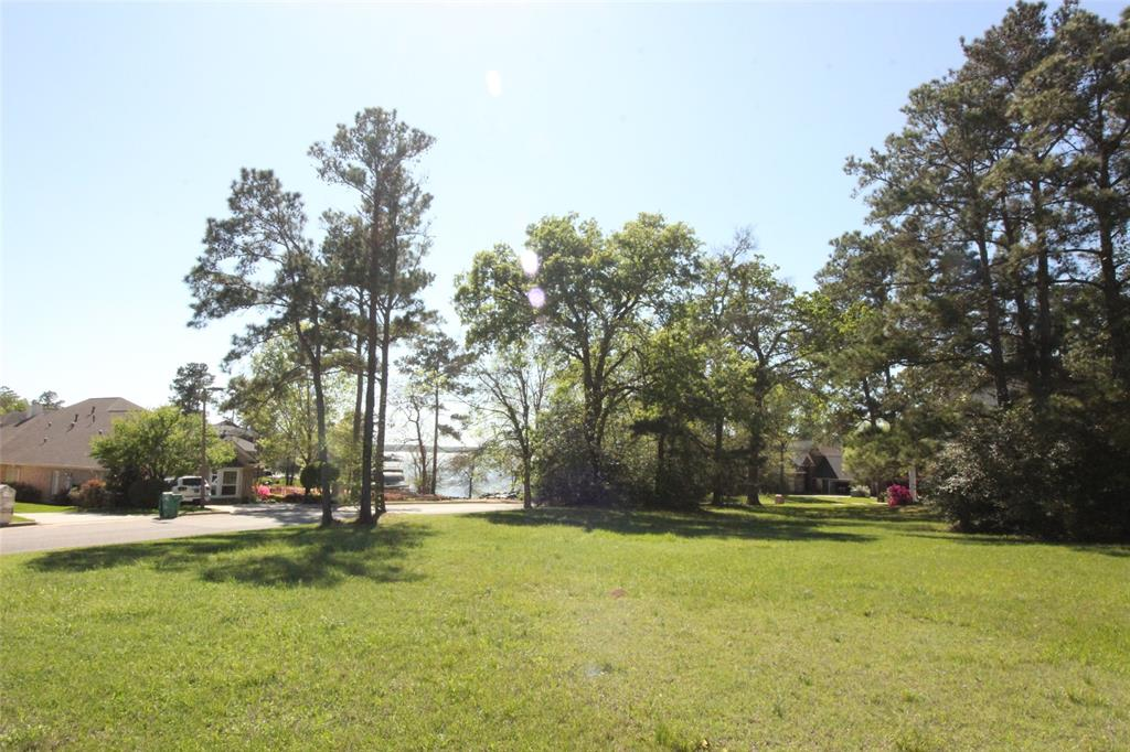 20k BELOW tax appraised value!!! Over HALF ACRE with a WATER VIEW to beautiful Lake Conroe! Longmire on Lake Conroe is in a wonderful location with deep water near the dam, and close to I-45 for your commute to services and jobs. It also has a very QUIET and PEACEFUL atmosphere as you drive back through the tree lined roads and back to a peninsula on Lake Conroe. This lot has the BEST of ALL WORLDS!!! There is a lake view and a community boat launch for nearby lake access! You have LOTS of SPACE with .6 acres that is WIDE and SPACIOUS instead of long and narrow like so many other lake lots. You are close to amenities and services with I-45, Conroe, and The Woodlands nearby, and yet you are away from it all! It's very quiet and peaceful in Longmire on Lake Conroe. This is a great opportunity with only a few lots left in this hidden gem on Lake Conroe.