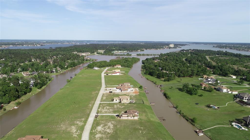 OVER HALF ACRE ON LAKE CONROE FOR UNDER 90K!!! This flat, and cleared lot is READY for a new home. The lot is SOUTH facing and offers GREAT VIEWS! Across the lake you are looking at Estate homes, and you are just a short distance from open Lake Conroe waters!!! Already bulkheaded as well! This was a builder preferred lot for the readiness for building a new custom home. Both neighbors on both sides of this lot have built homes now so you won't have to deal with construction down the line! Concrete streets, fiber optics, and beautiful homes make up the Island on Grand Harbor. The community has a park, community boat launch, and volley ball court as well. Montgomery ISD schools make it a great place to raise a family in this rapidly growing area. Grand Harbor is also a gated community with manned gates, and is nearby many nice golf courses when you aren't enjoying the lake. This is a great opportunity to get in on nice lake front property at a great price!