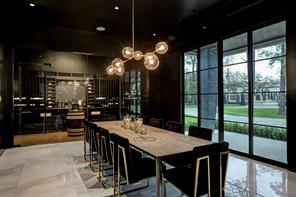 The dining area leads into a glass walled climate-controlled wine room with a cork floor finish.