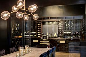 The wine room allows for an individual bottle capacity of approximately 500 and with additional storage, above and below, the wine room can amass a collection surpassing 1,000 bottles.