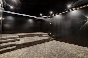 The Media Room boasts stadium-seating and is outfitted for a projector to encompass the entire wall