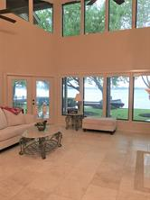 Welcome to the lake.  As soon as you enter the front door, your are welcomed by the wall of windows framing the water.