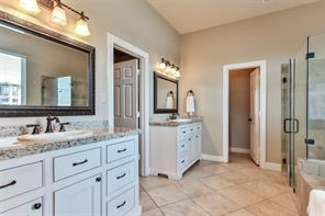 Double sinks and ample space in this master bath.