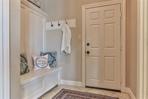 Mudroom with storage bench at garage entrance.