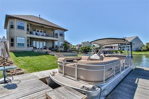 Dock area with boat slip with boat lift and a jet ski lift....summer lake fun abounds at 130 Harbour Town Circle!