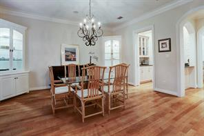 Spacious formal dining room with hardwoods and built-ins