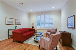 Formal living room with hardwoods, plantation shutters and French doors.  This space could have many uses.