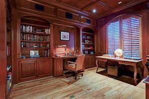 Handsome study with hardwoods, built-desk, shutters and secret door leading to master.