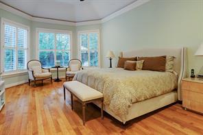 Spacious master bedroom with bay window overlooking the lush backyard.