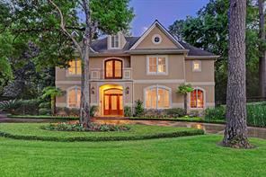 The custom built home was designed by John Sullivan and features a circular driveway, as well as, a gated large driveway with a built in basketball hoop and three car garage with a workshop.