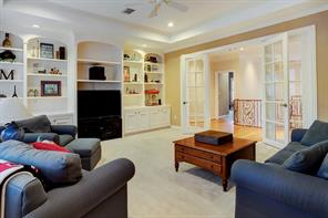 An upstairs large media room.  Hallway to the left also leads to a large storage area and an oversized fully lined cedar closet.