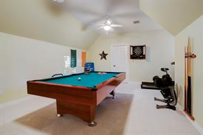 The home also features a game room which opens to a smaller room which could be a craft room.  Truly a place for everything in this home!!