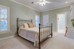 One of four secondary upstairs bedrooms with an en-suite bath.
