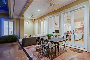 Covered patio off of the family room with ceiling fans and built-in speaker system on patio and throughout the home.