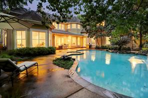 Such an amazing backyard!  There is a grassy area shown to the right (behind the pool) and not shown to left of the home is large grassy side yard.