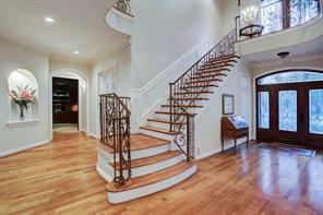 A lead glass door and wide entry with hardwood floors greet you as you enter this fabulous home.