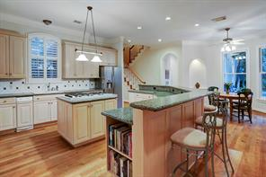 Spacious kitchen with Wood-Mode custom cabinets, gas cooktop, double ovens and large breakfast bar.