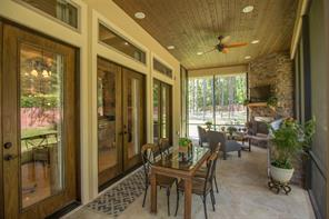 This view shows you the wall of French doors from the family room that open out onto the porch. Imagine these open for a party with your guests meandering from inside to outside. Wonderful!