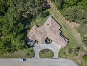 The home sits on a corner, cul-de-sac one-half acre Estate-sized lot. There is almost 60 feet of depth in the back yard. Its location in the gated community of Bentwater Bay Estates provides the ultimate in privacy.