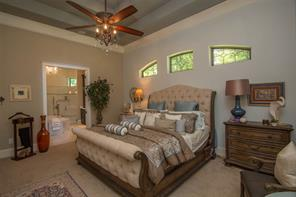 This view shows you the master bedroom with the open French doors leading to the master bath.