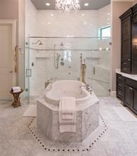 When you first enter the master bath, your eyes will open wide. It is GORGEOUS. There is European marble flooring, a walk-in 10 foot shower with seven shower heads, and a kidney shaped garden spa Jacuzzi whirlpool tub for two. Oh my. It's like a five star hotel in a world class resort.