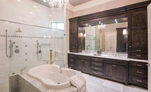 This photo shows you the 11 foot marble vanity with polished nickel Italian fixtures; notice the stenciling on the large cabinets.  Simply lovely.  Oh and the large master closet (21 square feet) with its build ins will make you smile.