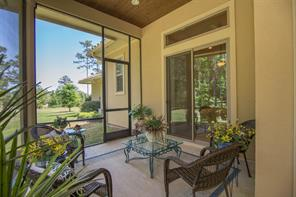 Here's a closer look at the screened porch.  So charming and inviting...come, sit and relax awhile.