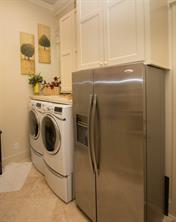 The utility room is quite large with loads of storage. There's even room for a side-by-side refrigerator.