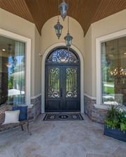 As you approach the home, you will see that the front entry portico has a 20 foot barrel vaulted ceiling, sculptured stone floors, top-of-the-line fixtures. The home wonderful curb appeal.