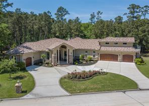 This aerial view shows you how captivating this one-story floor plan is. It takes a very special sized lot to accommodate this floor plan with 4 garages and a large circular driveway.