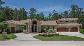 On the right side of the home there is a three car garage with water views. Sealed flooring, sink, work bench and multiple built-in storage areas. On the left side of the home there is a 4th garage for golf cart or a standard sized car. The doors are real cedar wood.